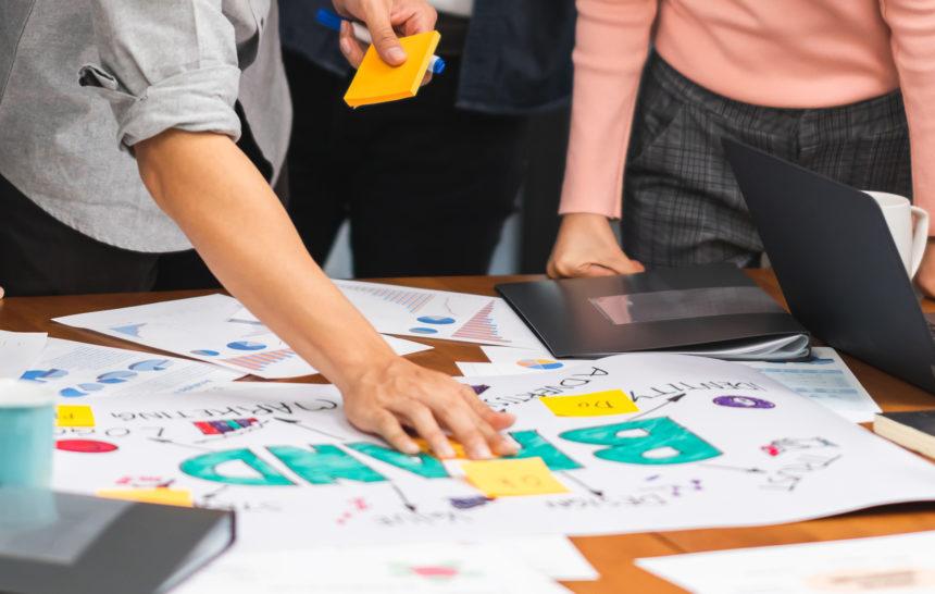 group of people designin branding strategy