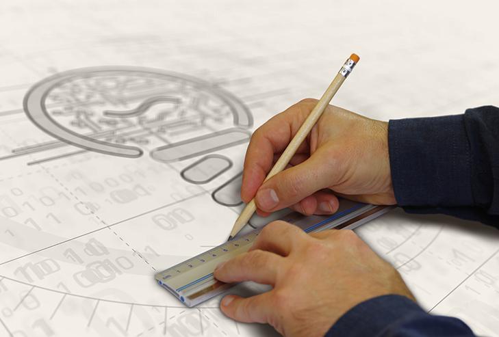keksijä piirtämässä